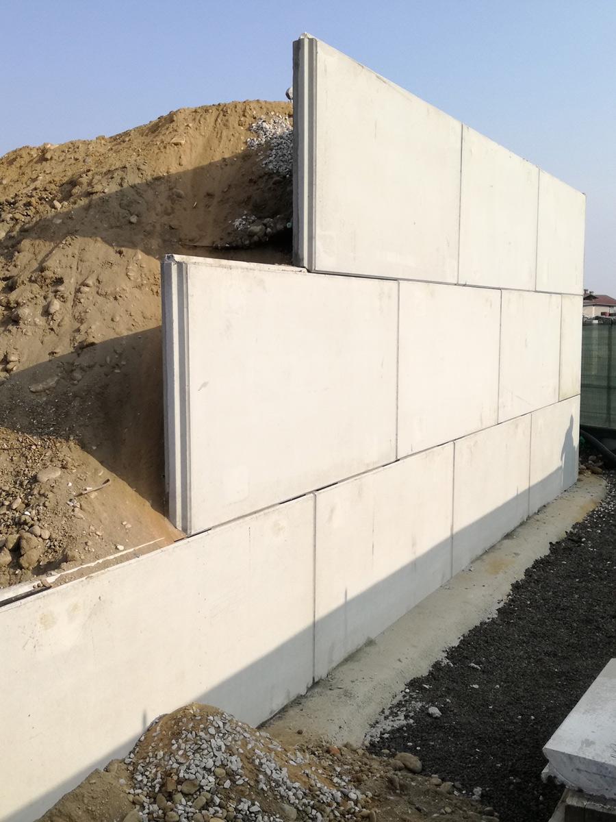 Muri a pannelli rinforzati con geogriglie Tenax